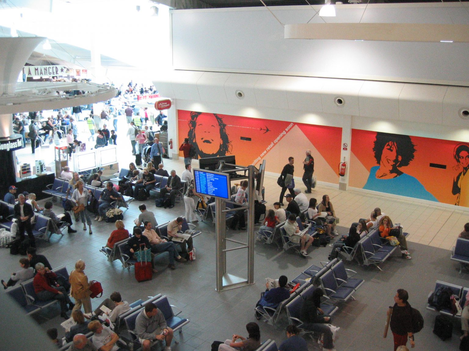 Flight information displays in waiting area
