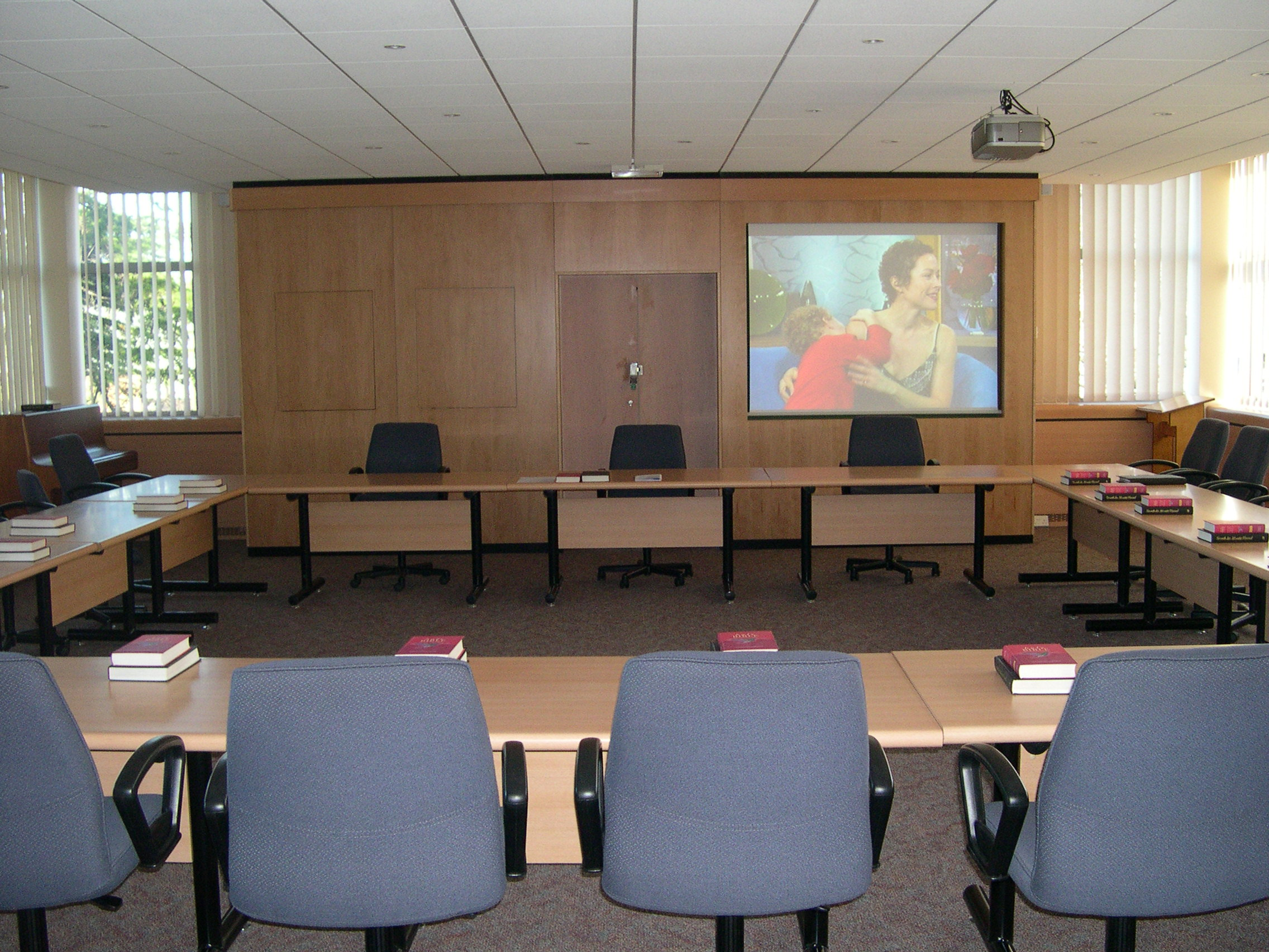Fixed projector with inset screen in meeting rooms