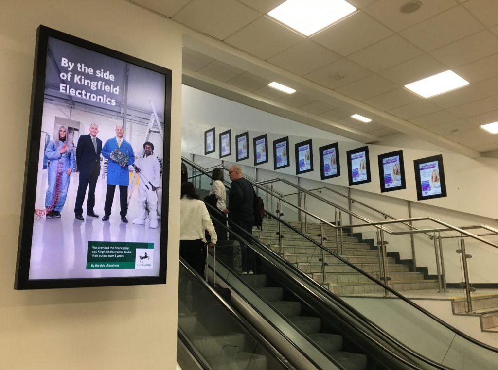 Digital signage content on multiple displays