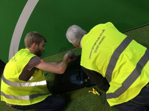 Health and Safety - Screen installation while wearing high visibility jacket
