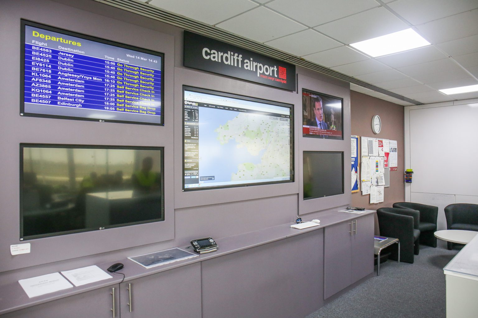 Multiple information screens and overview display in the operations centre of Cardiff Airport